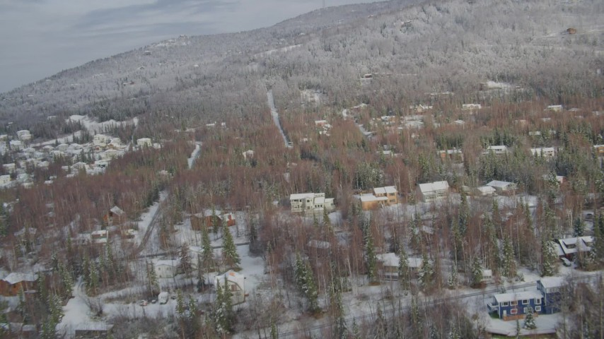 4K aerial video snowy residential neighborhood, Eagle River Valley, Eagle River, Alaska Aerial Stock Footage | AK0001_0751