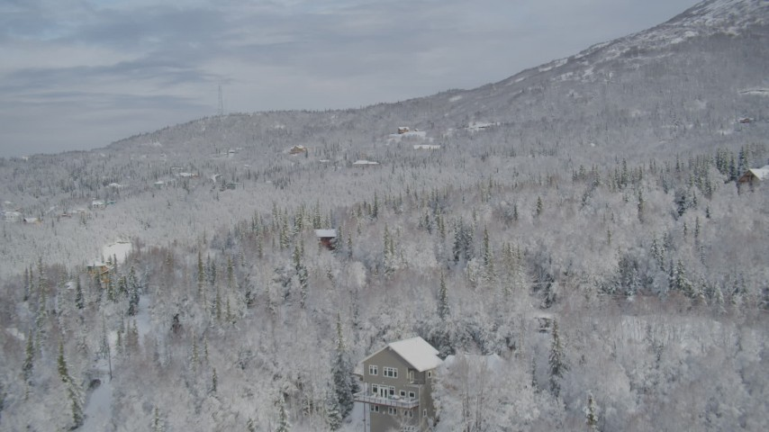 4K stock footage aerial video homes on snow-covered wooded slope, Eagle River Valley, Eagle River, Alaska Aerial Stock Footage | AK0001_0753