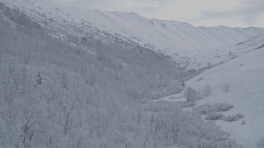 4K stock footage aerial video fly up slope of snow-covered Chugach Mountains, Alaska Aerial Stock Footage   AK0001_0768