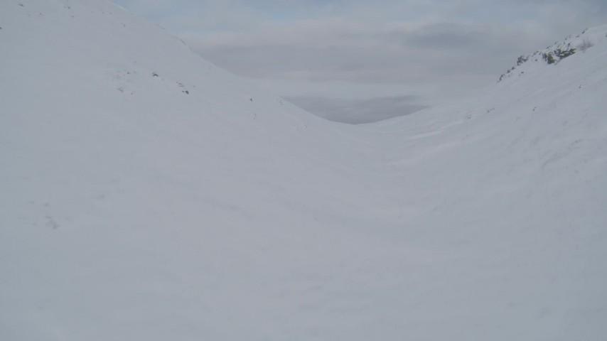 4K stock footage aerial video snowy ridge, Knik Arm of the Cook Inlet, Palmer Slough, Chugach Mountains, Alaska Aerial Stock Footage | AK0001_0769