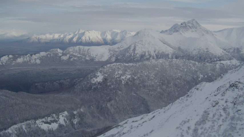 4K aerial video approaching snow-covered ranges of Chugach Mountains, Alaska Aerial Stock Footage | AK0001_0770