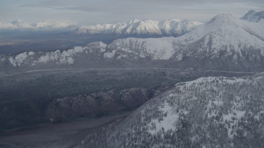 4K stock footage aerial video approaching wooded valley and snow-capped Chugach Mountains, Alaska Aerial Stock Footage   AK0001_0772