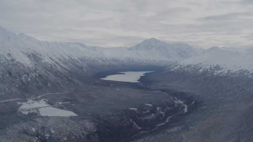 4K stock footage aerial video flying by snowy Chugach Mountains and Eklutna Lake, Alaska Aerial Stock Footage | AK0001_0774