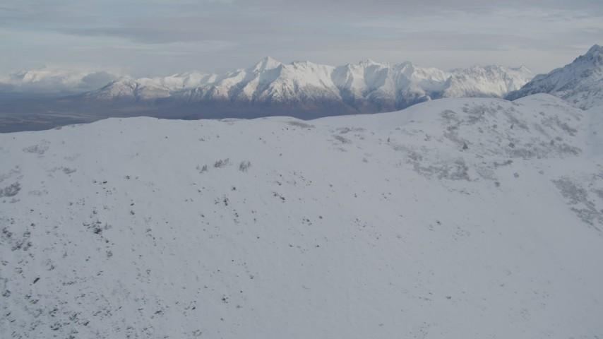 4K stock footage aerial video approach a snowy ridge in the Chugach Mountains, Alaska Aerial Stock Footage | AK0001_0777