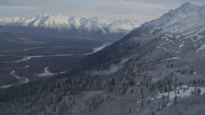 4K stock footage aerial video flying over grassy slope, reveal Knik River Valley, Chugach Mountains, Alaska Aerial Stock Footage | AK0001_0779
