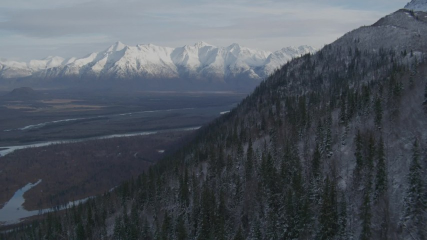 Approaching Knik River Valley toward snowy Chugach Mountains, Alaska Aerial Stock Footage   AK0001_0781