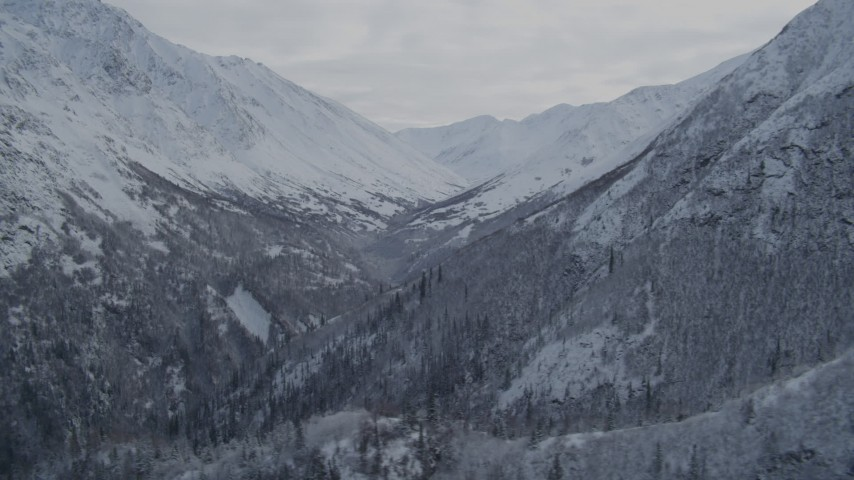 4K stock footage aerial video fly by narrow valley, snowy Chugach Mountains, Alaska Aerial Stock Footage | AK0001_0784