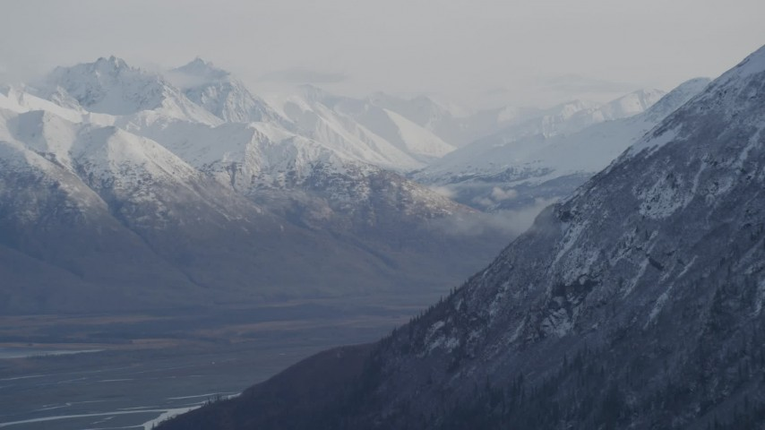 4K stock footage aerial video rounding mountain slope, revealing Knik River Valley, Chugach Mountains, Alaska Aerial Stock Footage | AK0001_0786