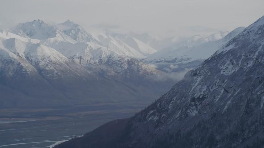 4K aerial video rounding mountain slope, revealing Knik River Valley, Chugach Mountains, Alaska Aerial Stock Footage | AK0001_0786