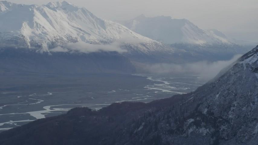 4K aerial video flying by Knik River Valley, reveal Knik Glacier, snow-capped Chugach Mountains, Alaska Aerial Stock Footage | AK0001_0787
