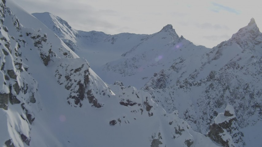 4K stock footage aerial video flying by rocky, snow-covered slopes, approach Chugach Mountains, Alaska Aerial Stock Footage | AK0001_0826