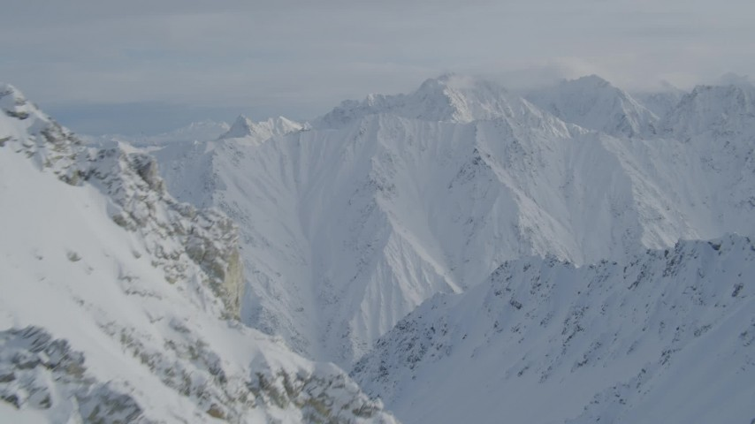 4K stock footage aerial video flying by snowy peak, reveal snowy range, Chugach Mountains, Alaska Aerial Stock Footage | AK0001_0839