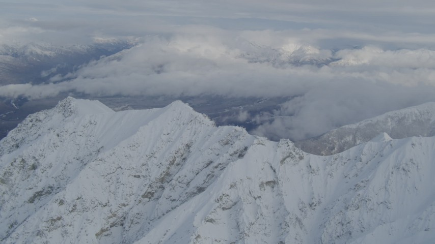 4K stock footage aerial video clouds and the snowy Chugach Mountains, Alaska Aerial Stock Footage AK0001_0842 | Axiom Images