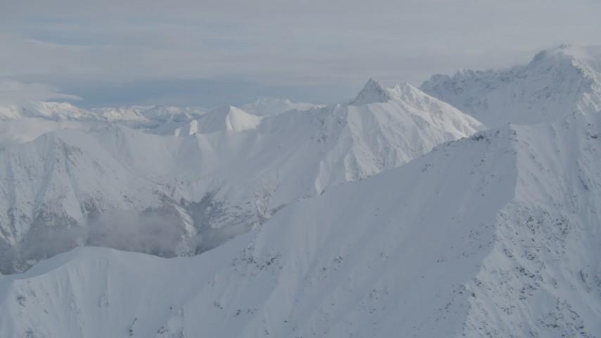 4K stock footage aerial video flying by snowy ridges, Chugach Mountains, Alaska Aerial Stock Footage | AK0001_0843