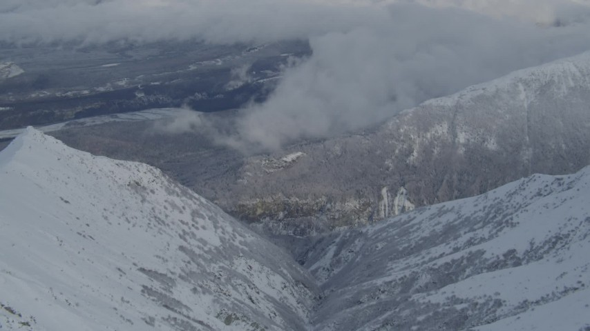 4K stock footage aerial video tilt to the Matanuska River Valley, snowy Chugach Mountains, Alaska Aerial Stock Footage | AK0001_0845