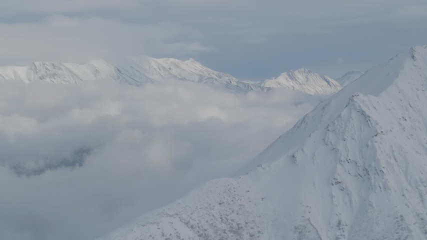 4K stock footage aerial video clouds beside the snowy Chugach Mountains, Alaska Aerial Stock Footage | AK0001_0846