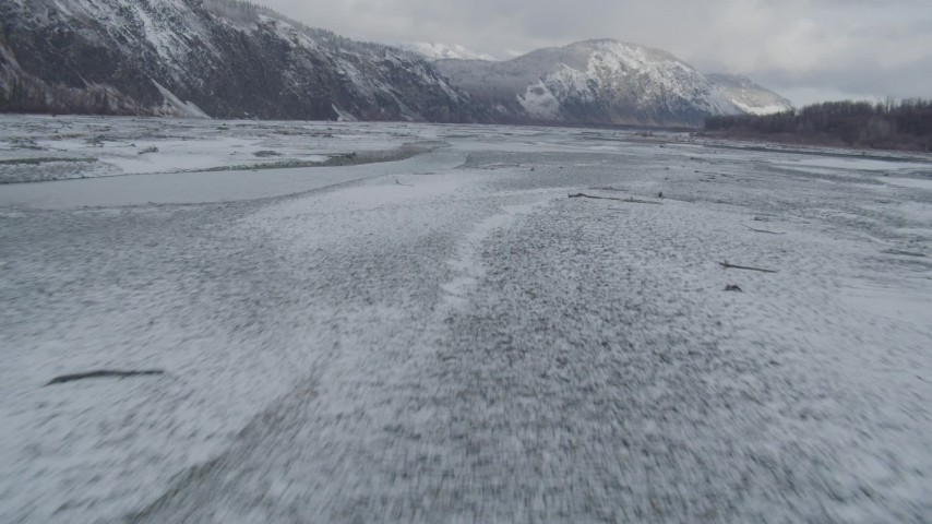 4K stock footage aerial video flying near snowy Talkeetna Mountains, over icy Matanuska River Valley, Alaska Aerial Stock Footage | AK0001_0853