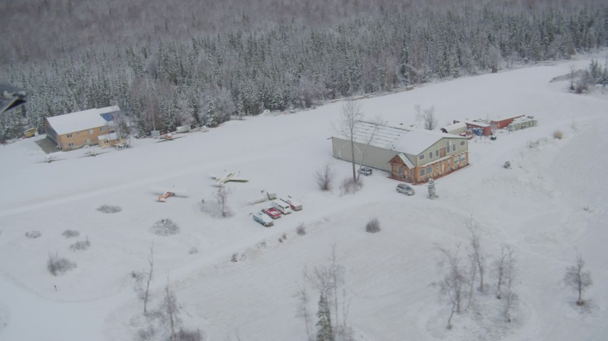 4K aerial video ascend and fly away from snowy King Ranch, Sutton, Alaska Aerial Stock Footage | AK0001_0862