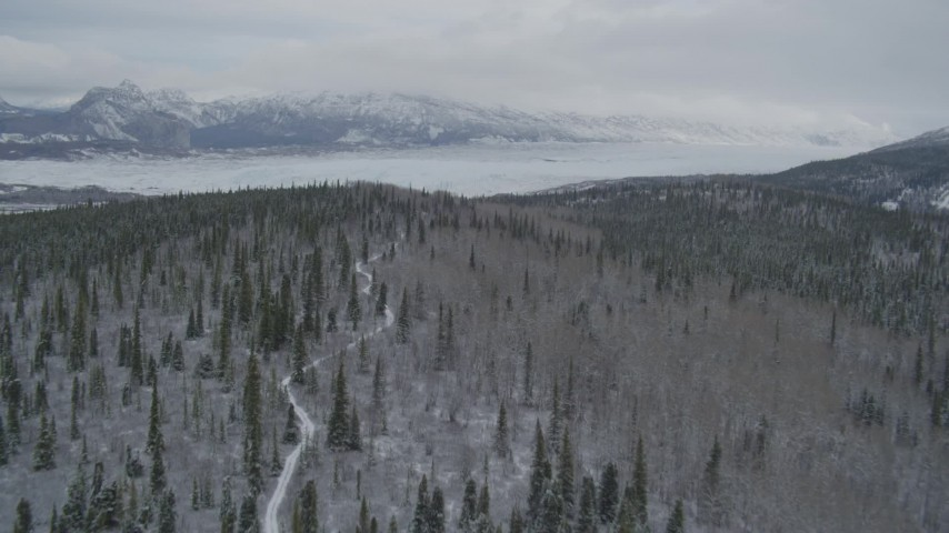 4K stock footage aerial video approaching snow-covered mountains beyond the Matanuska Glacier, Alaska Aerial Stock Footage | AK0001_0872