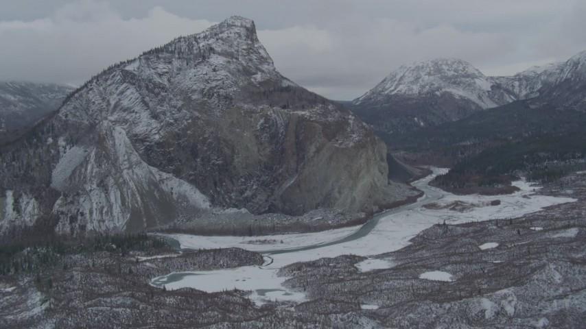 4K stock footage aerial video flying over hills toward a snow-capped rocky peak, Matanuska River Valley, Alaska Aerial Stock Footage   AK0001_0876