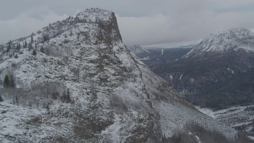 4K stock footage aerial video flying up the slope of a snowy rocky peak revealing Matanuska River Valley, Alaska Aerial Stock Footage   AK0001_0877