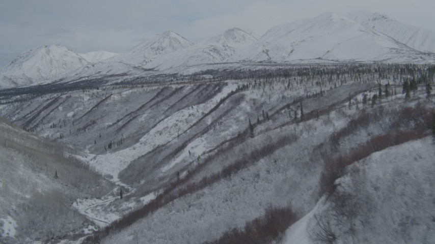 4K aerial stock footage video fly over gorge near the snow-covered Chugach Mountains, Alaskan Wilderness Aerial Stock Footage | AK0001_0884