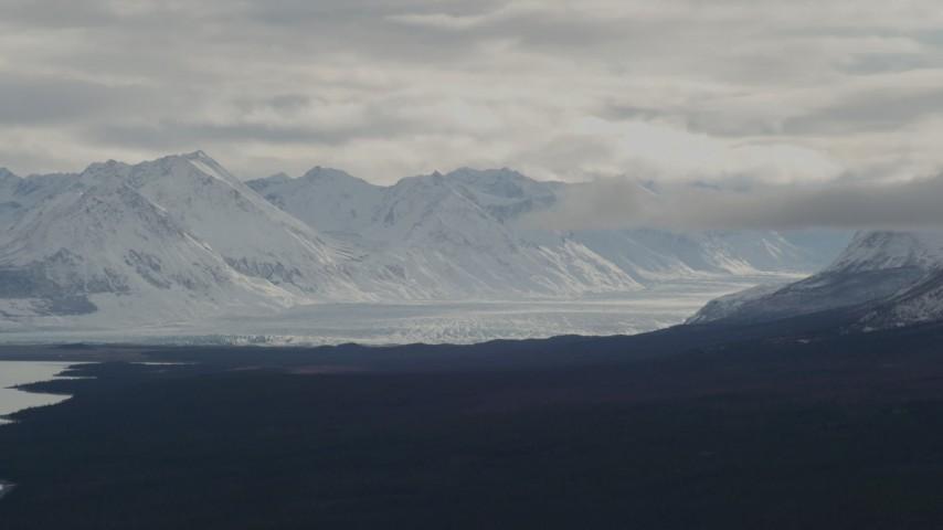 4K stock footage aerial video Tazlina Glacier in snow-covered Chugach Mountains near Tazlina Lake, Alaska Aerial Stock Footage | AK0001_0910