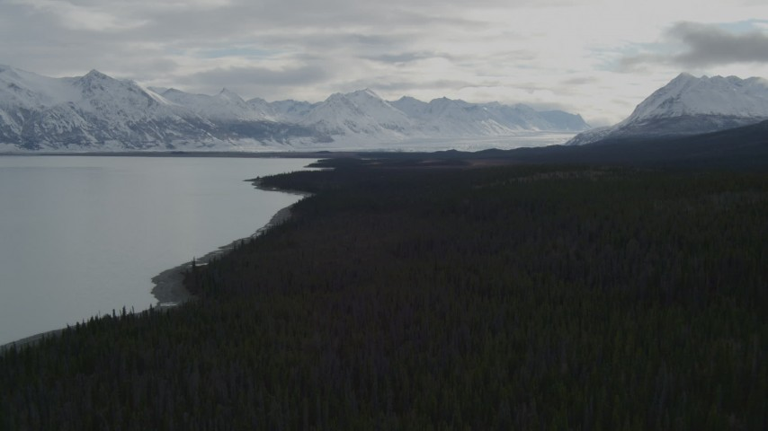 4K stock footage aerial video flying beside Tazlina Lake during winter toward snow covered Tazlina Glacier, Alaska Aerial Stock Footage   AK0001_0912