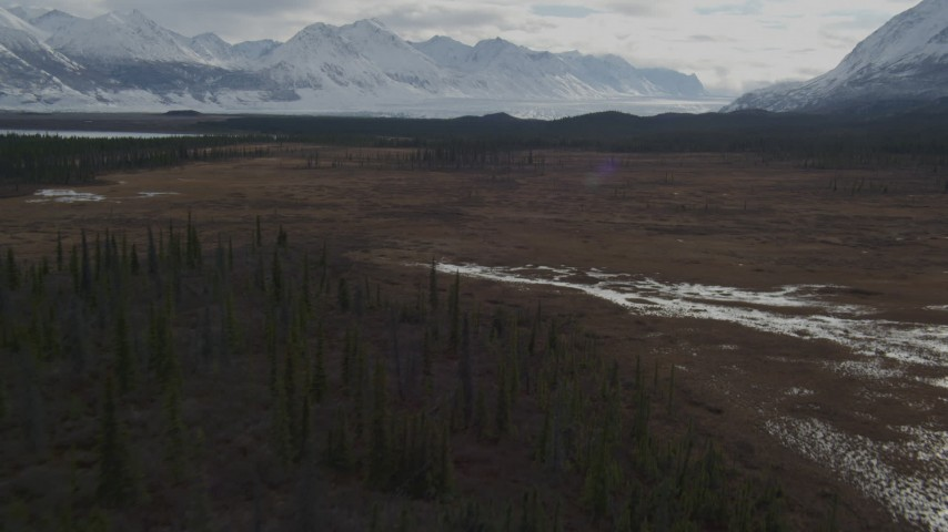 4K stock footage aerial video flying over wilderness with snow, during winter toward Tazlina Glacier, Tazlina Lake, Alaska Aerial Stock Footage | AK0001_0913