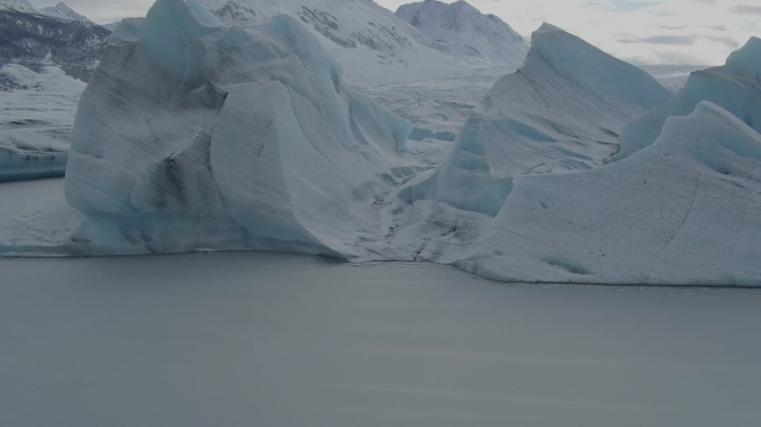 4K stock footage aerial video flying over glacial ice, revealing snow covered Tazlina Glacier during winter, Tazlina Lake, Alaska Aerial Stock Footage | AK0001_0918