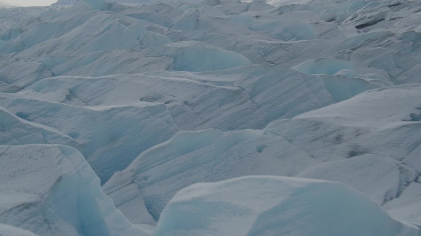 4K stock footage aerial video flying over snow covered surface of the Tazlina Glacier, Alaska Aerial Stock Footage | AK0001_0921