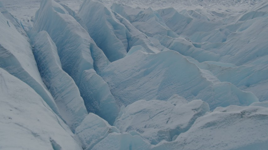 4K stock footage aerial video flying over snow covered surface of the Tazlina Glacier, Alaska Aerial Stock Footage | AK0001_0922