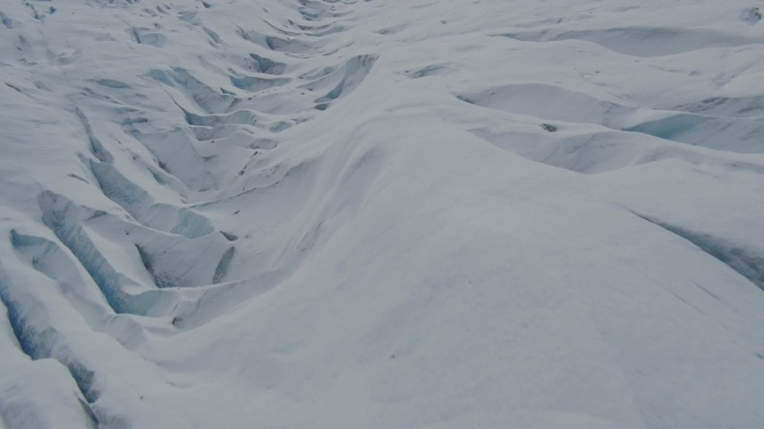 4K stock footage aerial video flying over snow covered surface of the Tazlina Glacier, Alaska Aerial Stock Footage | AK0001_0923