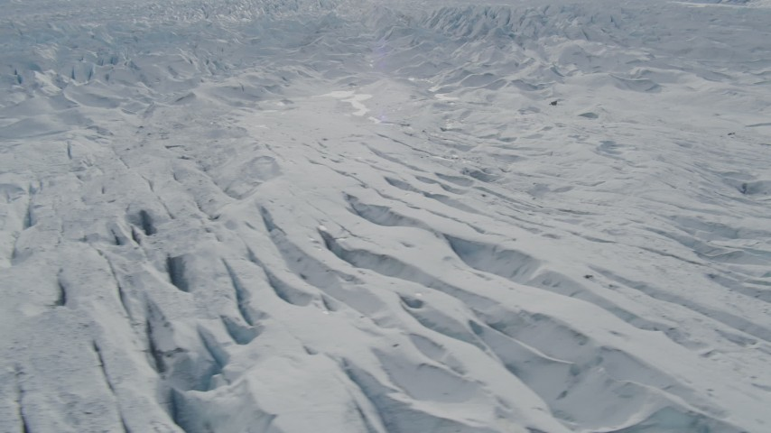 4K stock footage aerial video flying over snow covered surface of the Tazlina Glacier, Alaska Aerial Stock Footage | AK0001_0924