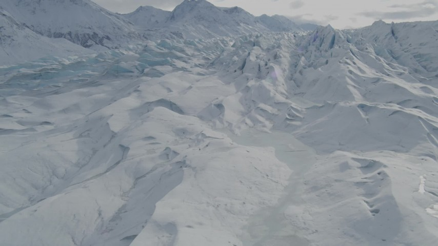 4K stock footage aerial video flying over snow covered surface of the Tazlina Glacier, Alaska Aerial Stock Footage AK0001_0925 | Axiom Images