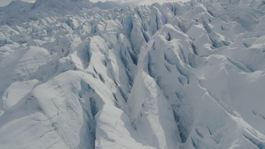 4K stock footage aerial video flying over snow covered surface of the Tazlina Glacier, Alaska Aerial Stock Footage AK0001_0928 | Axiom Images