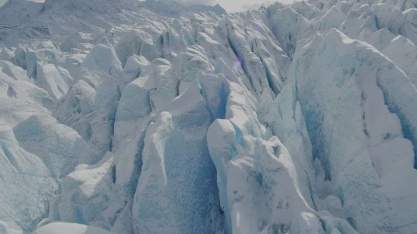 4K stock footage aerial video flying over snow covered surface of the Tazlina Glacier, Alaska Aerial Stock Footage | AK0001_0929