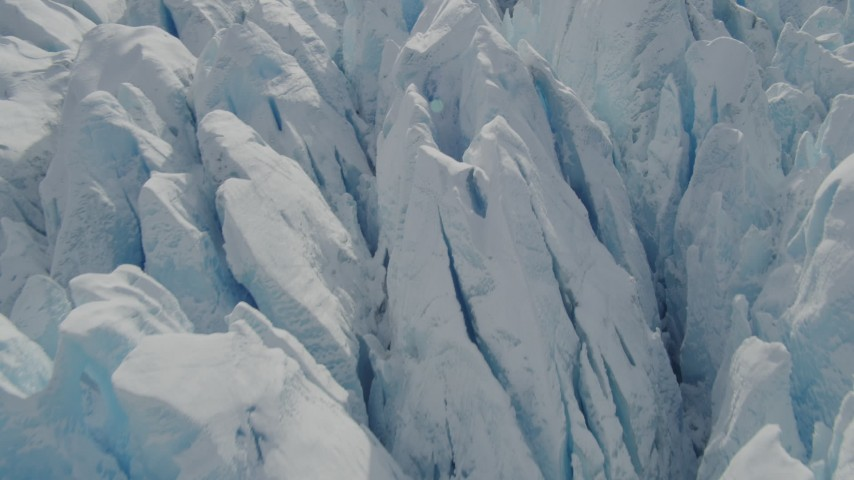 4K stock footage aerial video flying over snow covered surface of the Tazlina Glacier, Alaska Aerial Stock Footage | AK0001_0930