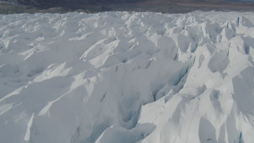 4K stock footage aerial video flying over snow covered surface of the Tazlina Glacier, Alaska Aerial Stock Footage | AK0001_0932
