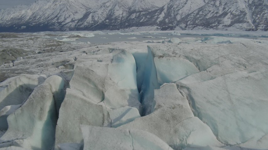 4K stock footage aerial video approaching Tazlina Lake, during winter, over icy, snow covered surface of Tazlina Glacier, Alaska Aerial Stock Footage | AK0001_0938