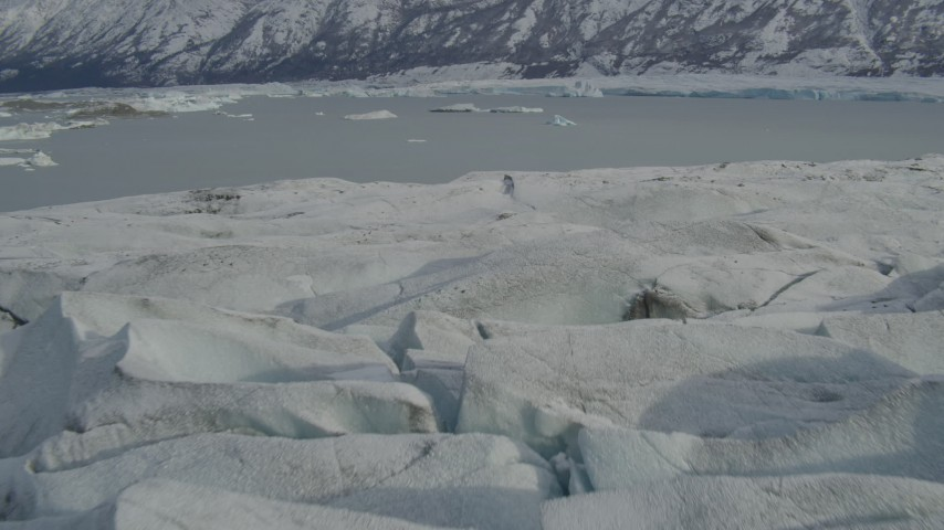 4K stock footage aerial video approach Tazlina Lake, during winter, over edge of snow covered Tazlina Glacier, Alaska Aerial Stock Footage | AK0001_0939