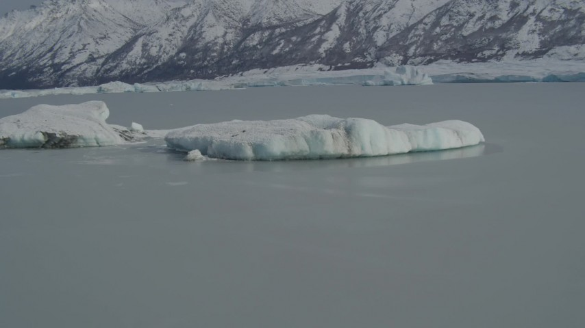 4K stock footage aerial video fly over glacial ice toward snow covered Tazlina Glacier, during winter, Tazlina Lake, Alaska Aerial Stock Footage   AK0001_0940