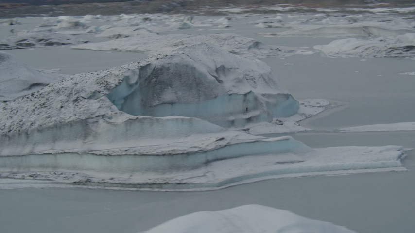 4K stock footage aerial video flying over snow covered glacial ice during winter, Tazlina Lake, Alaska Aerial Stock Footage | AK0001_0949