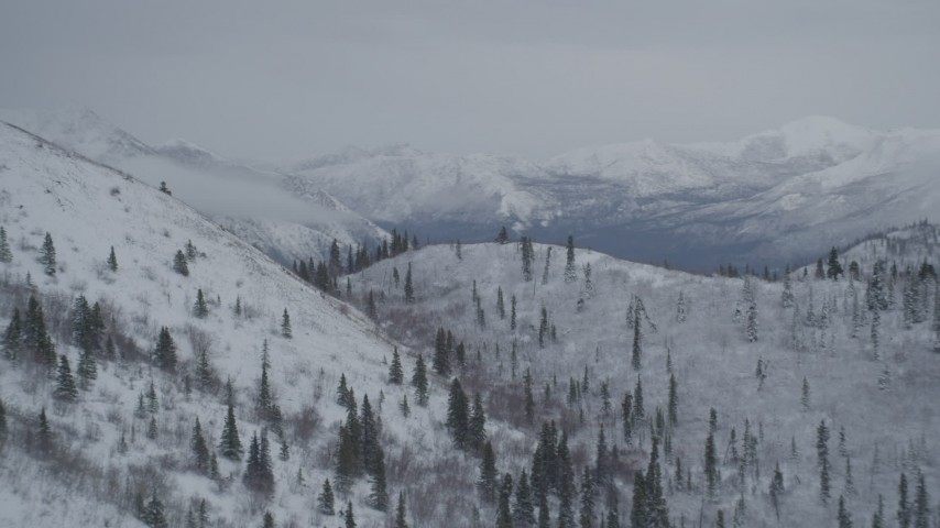 4K aerial video flying by snowy slopes in the Chugach Mountains, Alaska Aerial Stock Footage | AK0001_0957
