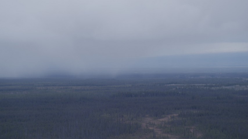 4K stock footage aerial video flying away from low clouds over forest, Alaskan Wilderness Aerial Stock Footage | AK0001_1021