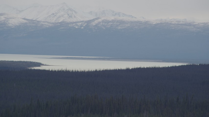 4K stock footage aerial video the Tazlina Lake at the base of the snow covered Chugach Mountains, Alaska Aerial Stock Footage | AK0001_1027
