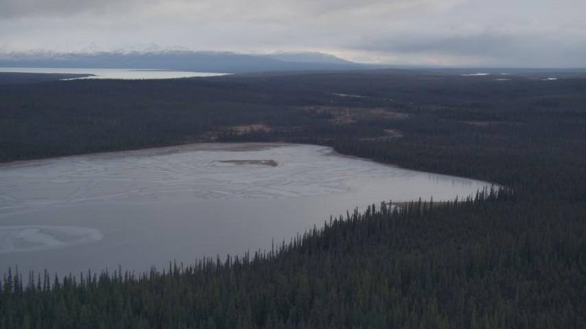 4K aerial video flying over a small lake towards Tazlina Lake, Alaska Aerial Stock Footage | AK0001_1028