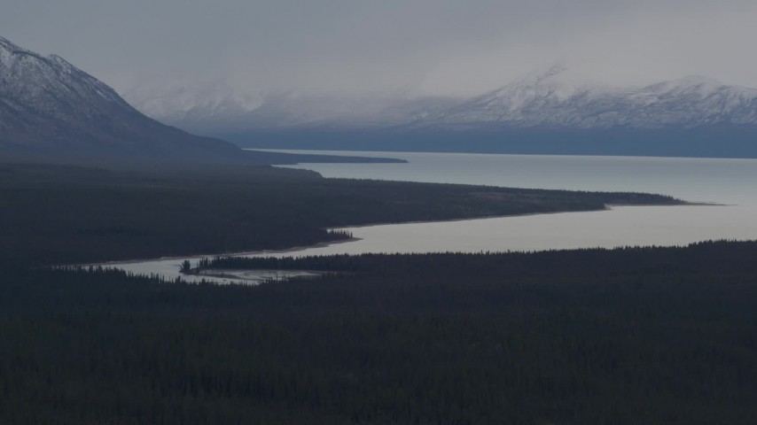 4K stock footage aerial video Tazlina Lake bordered by forest and snow capped Chugach Mountains, Alaska Aerial Stock Footage | AK0001_1029