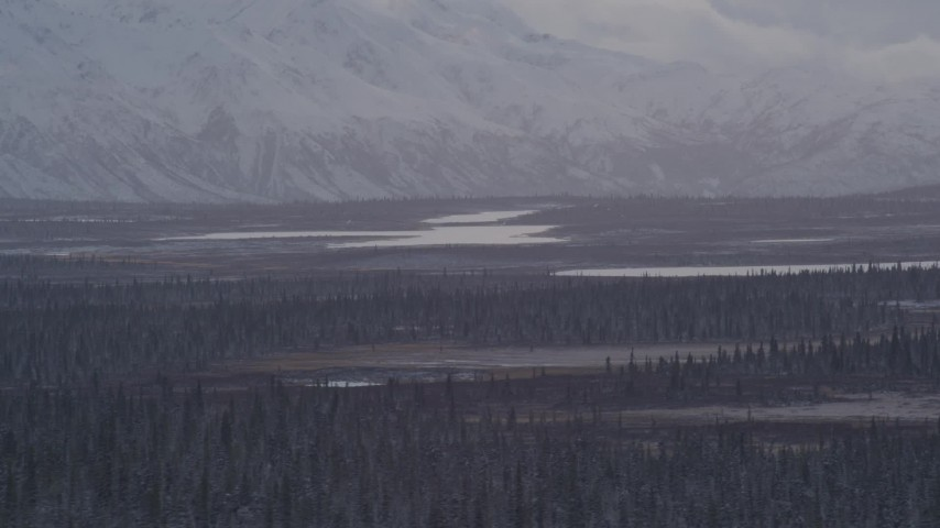 4K aerial video Lake Leila and Trail Lake at base of snow covered Chugach Mountains, Alaska Aerial Stock Footage | AK0001_1052