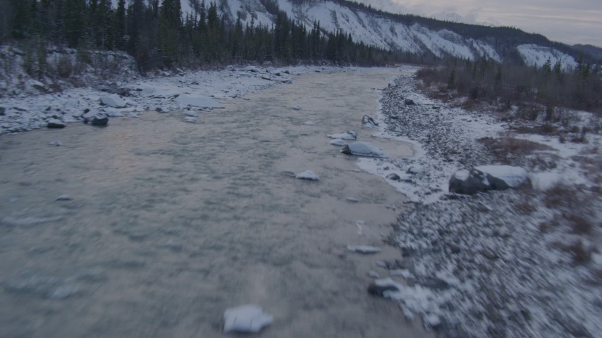 4K stock footage aerial video following the Matanuska River and snow covered shore, Alaska Aerial Stock Footage | AK0001_1075